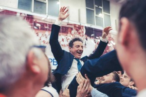 coach Massimo Riga portato in festa dopo la promozione in A1